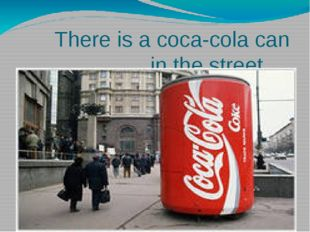 There is a coca-cola can in the street