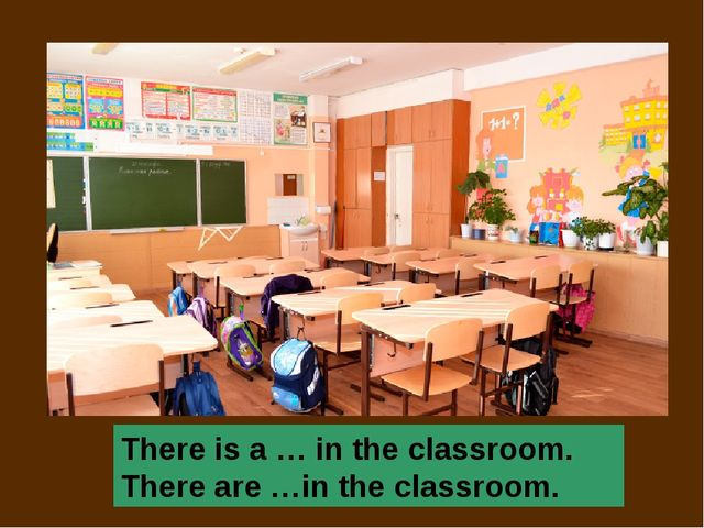 There is a … in the classroom. There are …in the classroom.