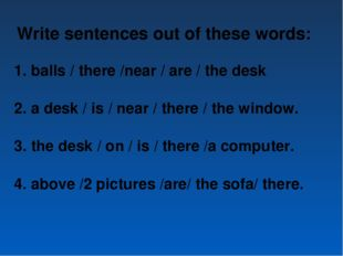 Write sentences out of these words: balls / there /near / are / the desk a de