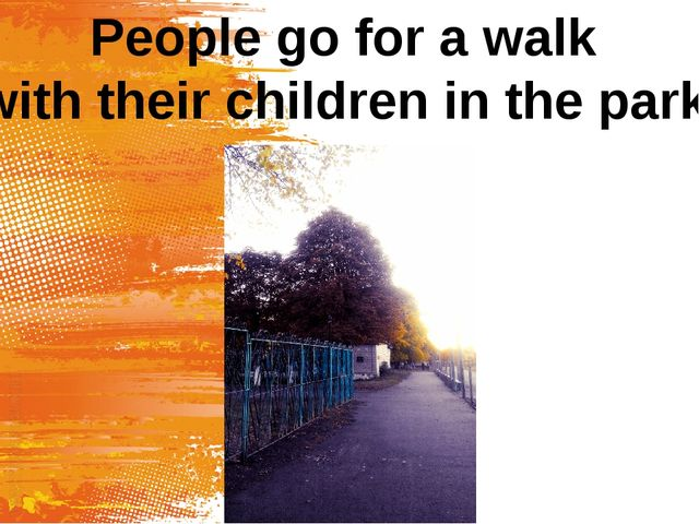 People go for a walk with their children in the park.