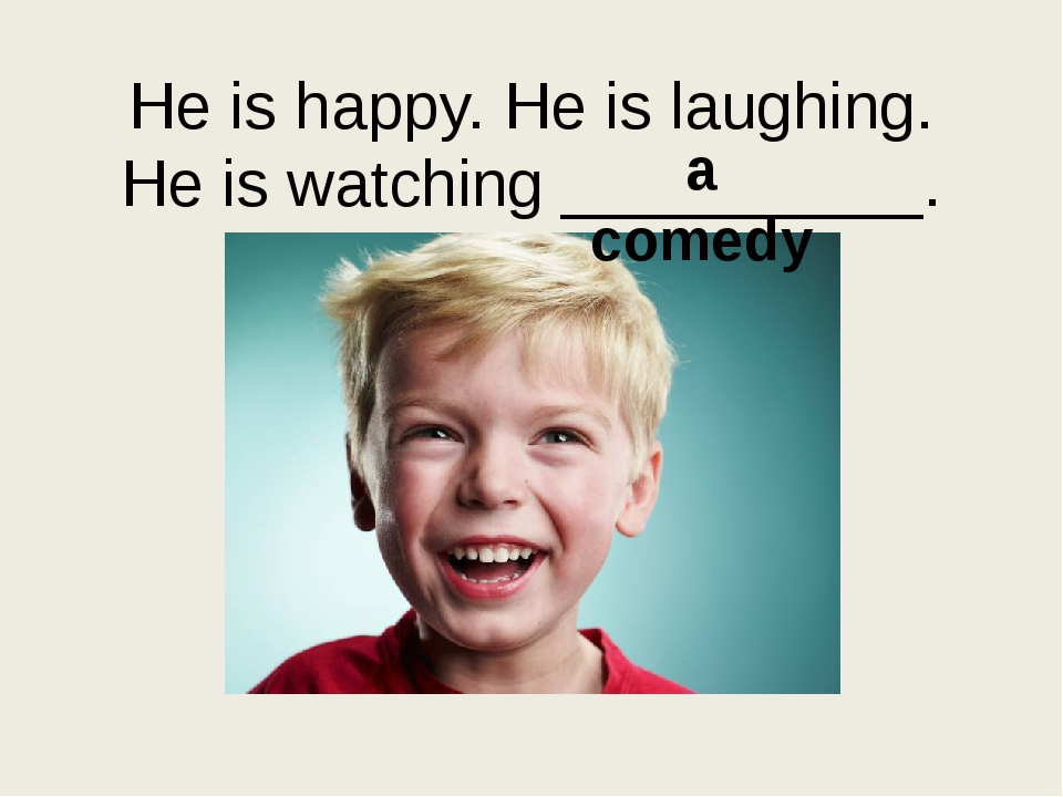He is happy. He is laughing. He is watching __________. a comedy
