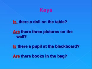 Keys Is there a doll on the table? Are there three pictures on the wall? Is t