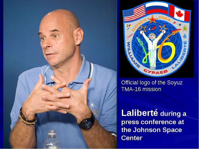 Laliberté during a press conference at the Johnson Space Center Official logo...