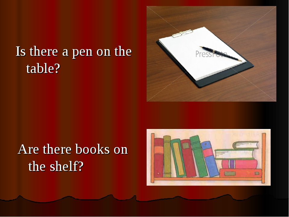 Is there a pen on the table? Are there books on the shelf?