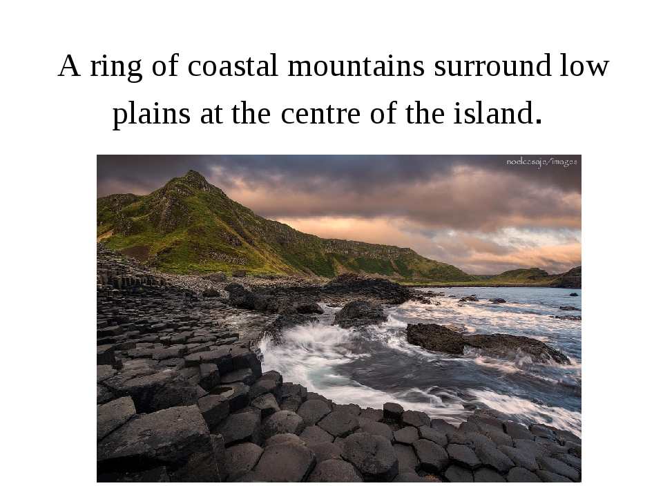 A ring of coastal mountains surround low plains at the centre of the island.