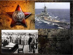 Представитель СССР К. Н. Деревянко ставит свою подпись под актом о капитуляц