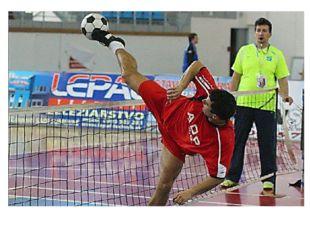 Футболтеннис— командный вид спорта, игра футбольным мячом через теннисную сет