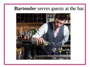 Bartender serves guests at the bar.