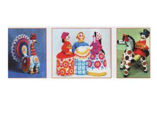 Дымковская глиняная игрушка нарядная, она украшена сочными красными, синими,