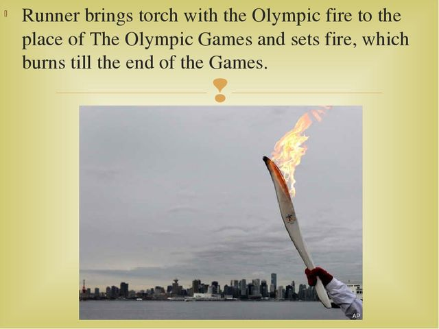 Runner brings torch with the Olympic fire to the place of The Olympic Games a...