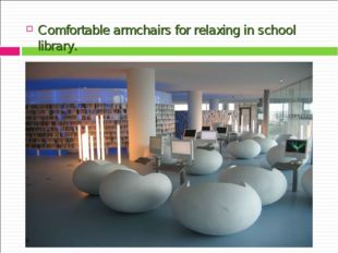Comfortable armchairs for relaxing in school library.
