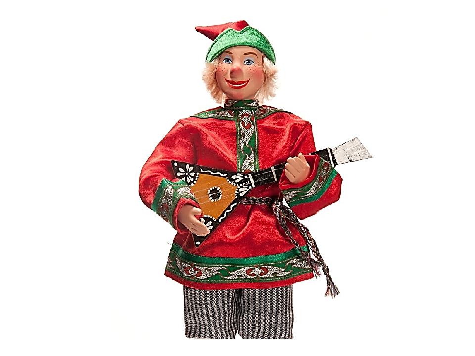 Петрушка русский шут, потешник, одет в красный кафтан и колпак.