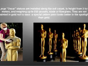 """Large """"Oscar"""" statues are installed along the red carpet, in height from 3 to"""
