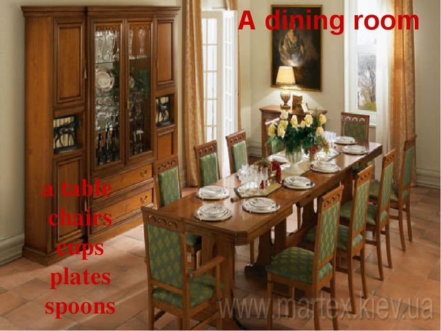 A dining room a table chairs cups plates spoons