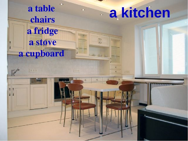 a kitchen a table chairs a fridge a stove a cupboard