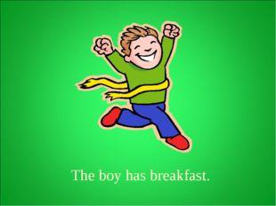 The boy has breakfast.