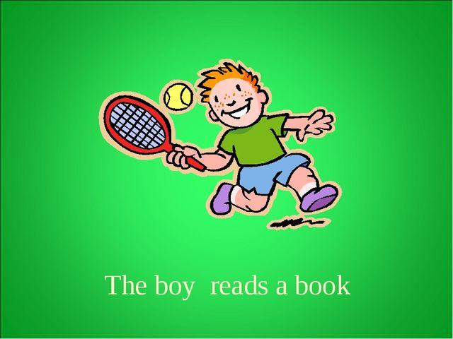 The boy reads a book