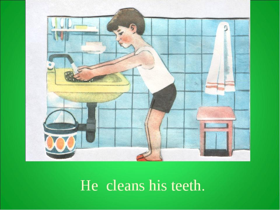 He cleans his teeth.