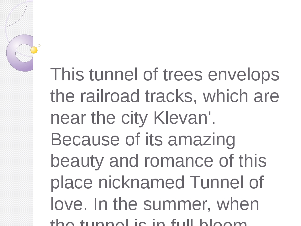 This tunnel of trees envelops the railroad tracks, which are near the city K...