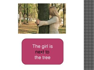 The girl is … the tree next to