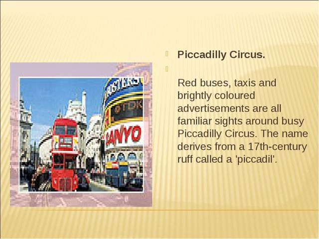 Piccadilly Circus. Red buses, taxis and brightly coloured advertisements are...