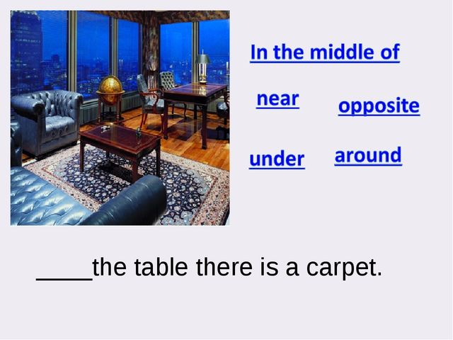 ____the table there is a carpet.