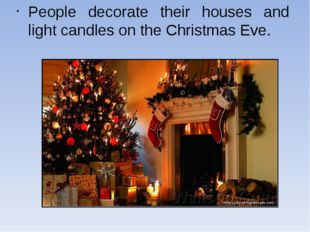 People decorate their houses and light candles on the Christmas Eve.