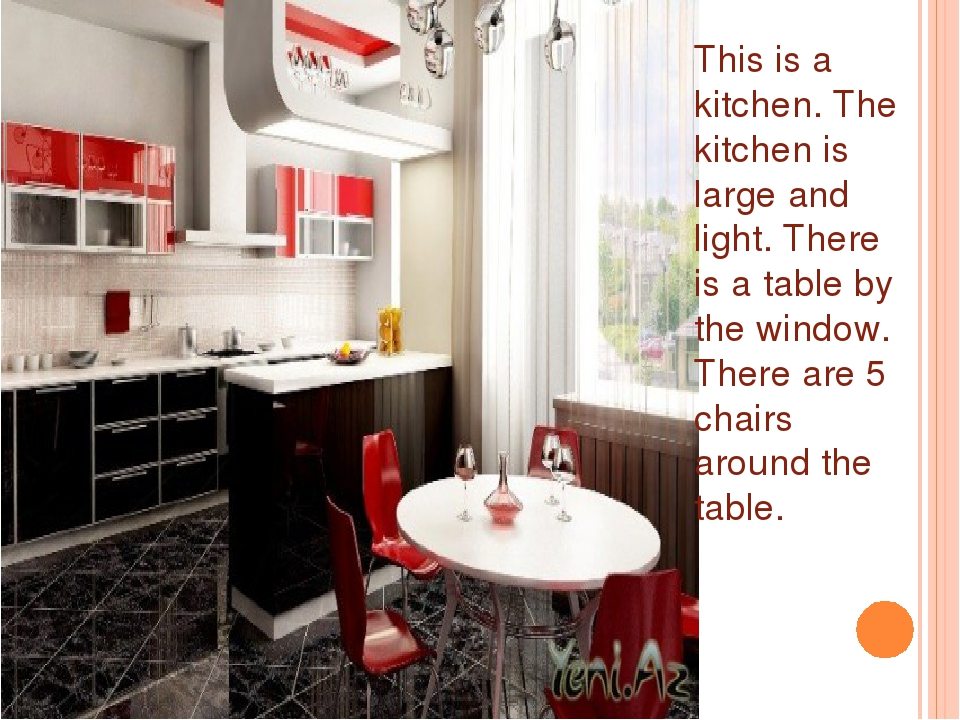 This is a kitchen. The kitchen is large and light. There is a table by the wi...