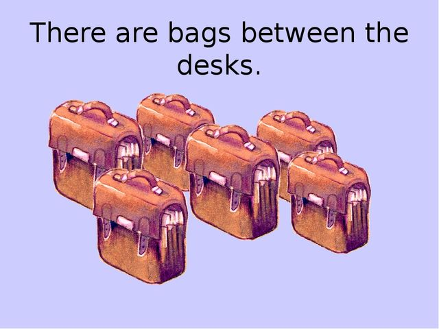 There are bags between the desks.