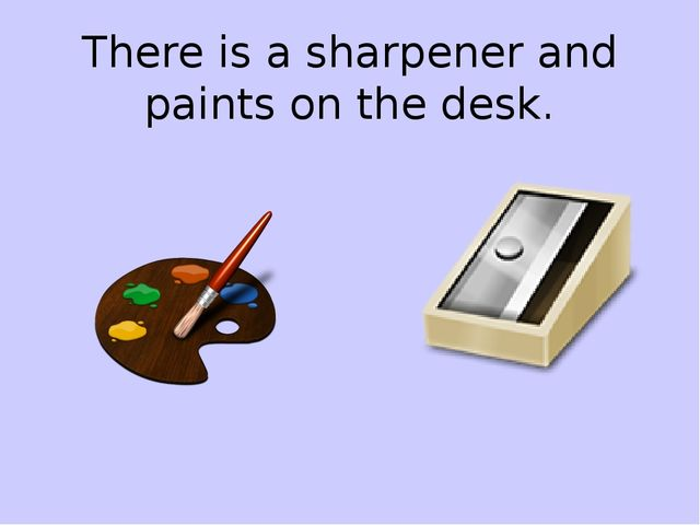 There is a sharpener and paints on the desk.
