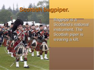 Scottish bagpiper. Bagpipe is a Scotland's national instrument. The Scottish