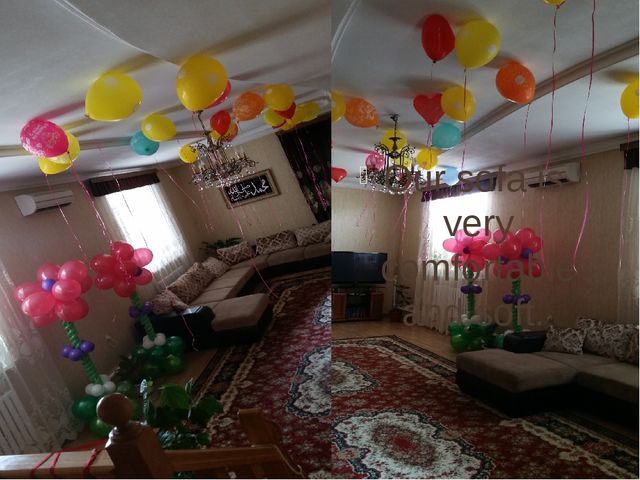 There is a sofa next to the door. You can see a lot of baloons in the room....