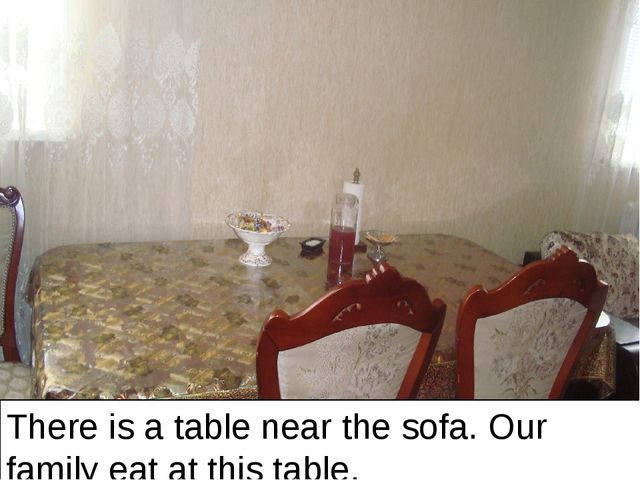 There is a table near the sofa. Our family eat at this table.