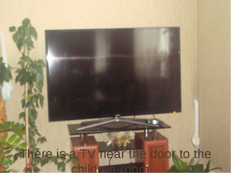 There is a TV near the door to the children-room.
