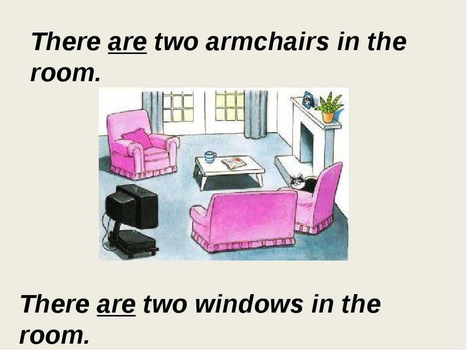 There are two armchairs in the room. There are two windows in the room.